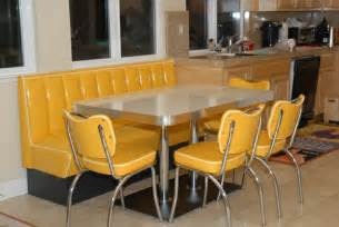 This retro kitchen booth is done in a yellow cracked ice and features