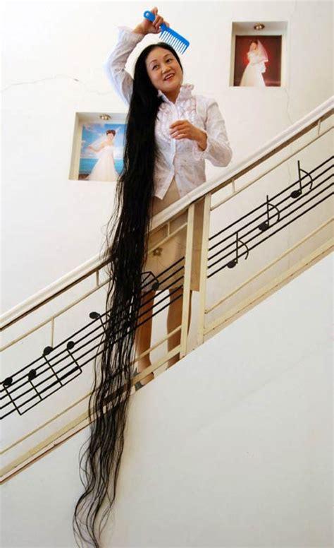 guiness record holder for longest hair women with longest hair guinness book of world records
