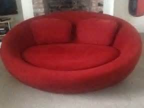 red round sofa red round oval snuggle chair sofa