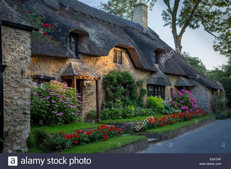 thatch roof cottage in broad cden the cotswolds