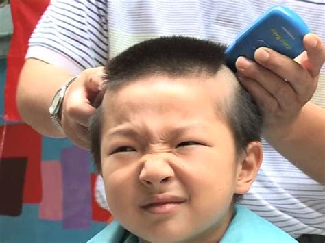 haircut games chinese boy hairstyle olympic games beijing china sd stock