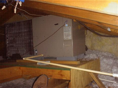 Attic Mounted Air Conditioning System - does a heat or air conditioner condenser need to go