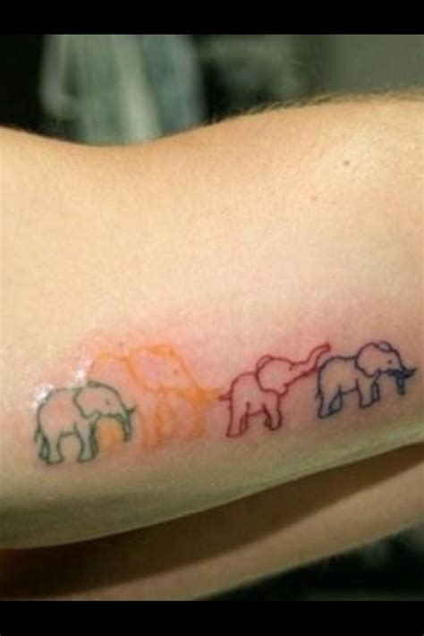 tattoo designs that mean family elephant representing a family um but put the