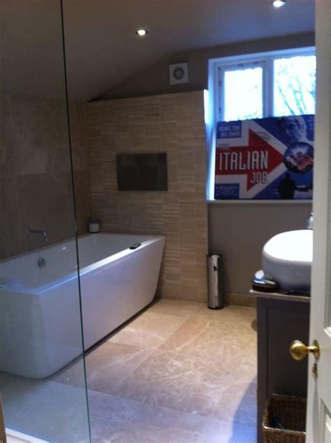 spacious bathroom  classic bath tub  glass panel