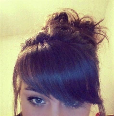 how to comb a bun with side swept bangs thick side swept bangs and messy bun did my bangs myself