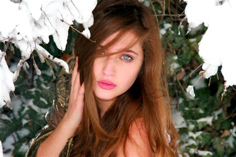 girl with brown hair in snow free images person snow winter girl flower model