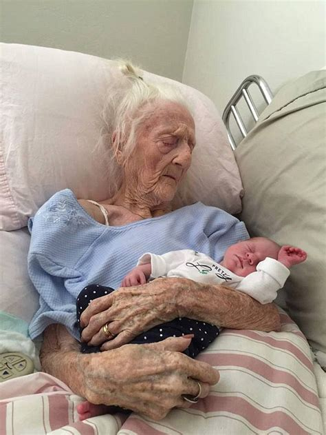 rosa camfield 101 holding great granddaughter in