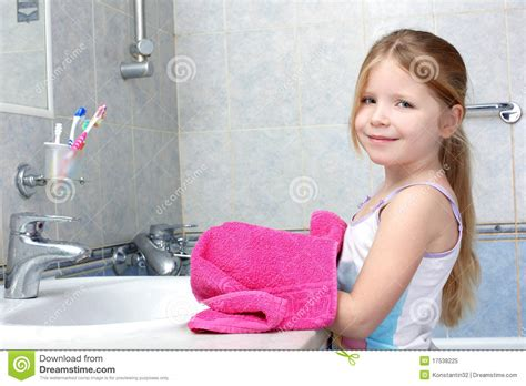 girl on girl in bathroom girl taken towel in bathroom royalty free stock photo
