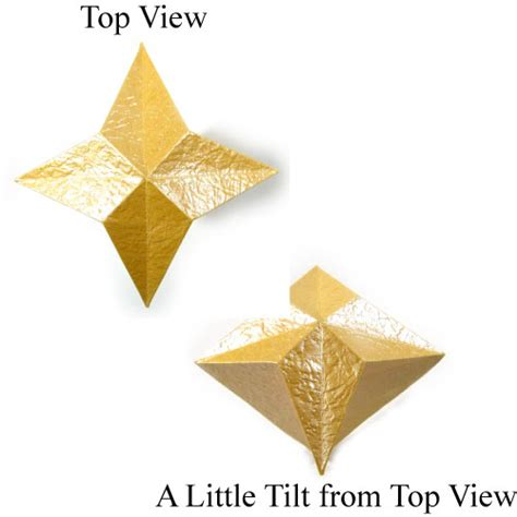 4 Pointed Origami - how to make a 3d four pointed origami page 1