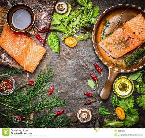 rustic cooking salmon fillet on rustic kitchen table with fresh