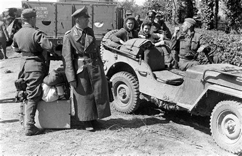 ww2 german jeep ww2 photo wwii german soldiers captured jeep falaise gap