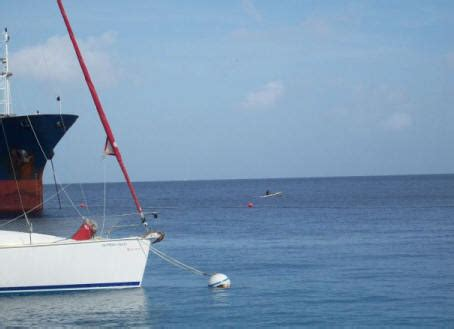 boat horn blows three times island time visits mustique