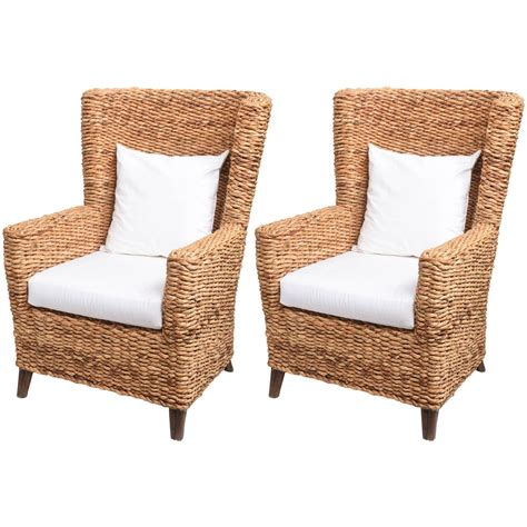 banana leaf armchair pair of large woven banana leaf wing chairs at 1stdibs