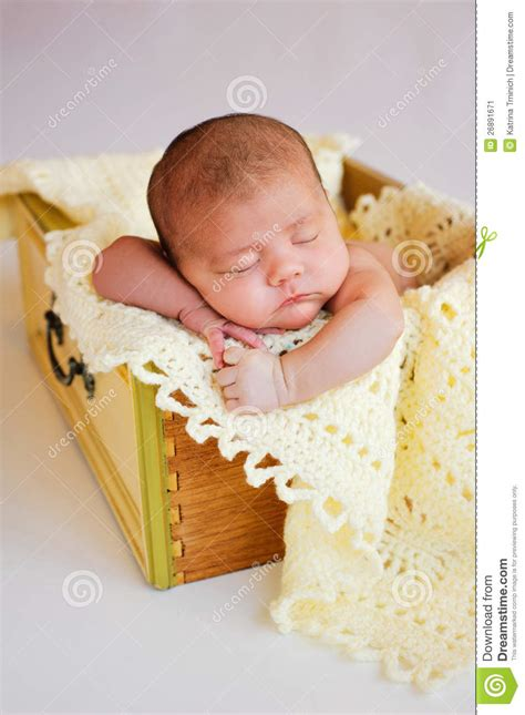 Baby In Drawer by Newborn Baby Sleeping In Yellow Drawer Stock Image