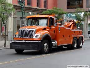 Trucks besides camaro tow truck towing on repo tow trucks for sale