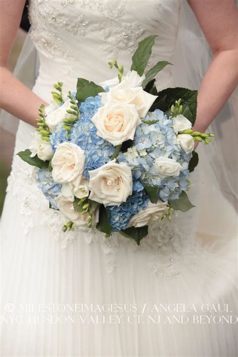 bridal bouquet made of white roses and blue hydrangeas