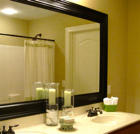 framing your bathroom mirror how to add a frame to your bathroom mirror