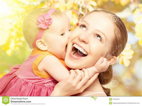 mom images happy cheerful family mother and baby kissing in nature outdoor stock image image 31165407