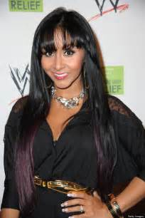 Snooki shows off weight loss slams reports claiming she s using