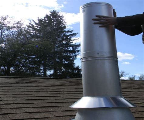 chimney pipe installation for wood stove through a flat