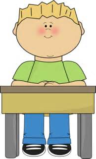 student at a desk student sitting at school desk card clip student
