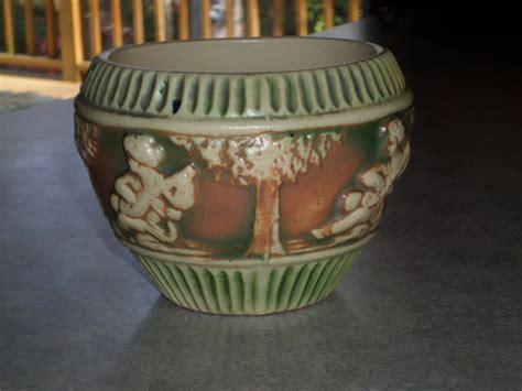 bead store roseville 1915 roseville pottery small donatello cherub and tree