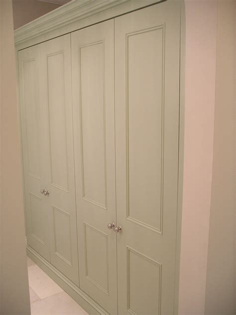 made to measure fitted linen cupboard with panel doors