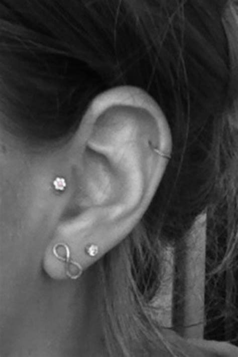 just got ears pierced when do i remove the studs just got my tragus pierced i have a normal earring in at