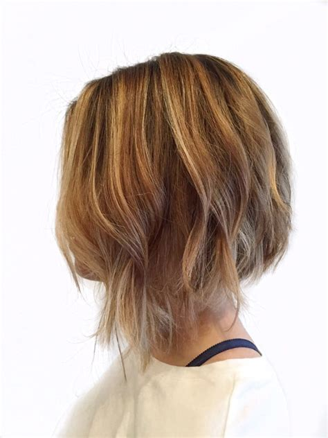 blonde bob undercut asymmetrical bob with soft undercut and blonde balayage