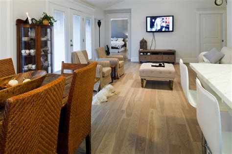 living room beach cottage with wood flooring and sloped ceiling beach house contemporary living room ottawa by