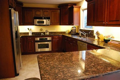 yellow and brown kitchen ideas yellow walls cherry cupboards brown counter tan floor
