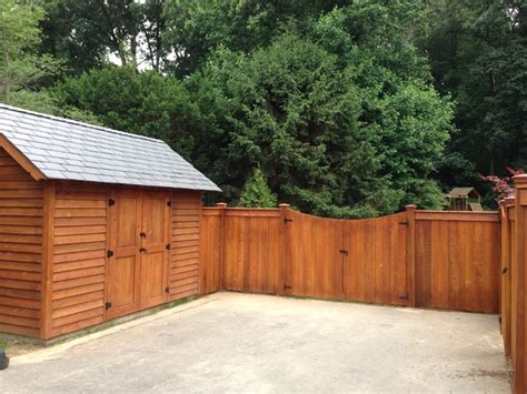Shed Fence by Cedar Fence With Matching Shed Craftsman Garage And Shed