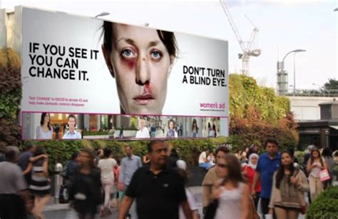domestic violence billboard dares people not to look away each time someone looks the bruised woman on this