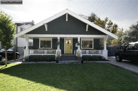 gray house yellow door grey bungalow with yellow door house exteriors pinterest