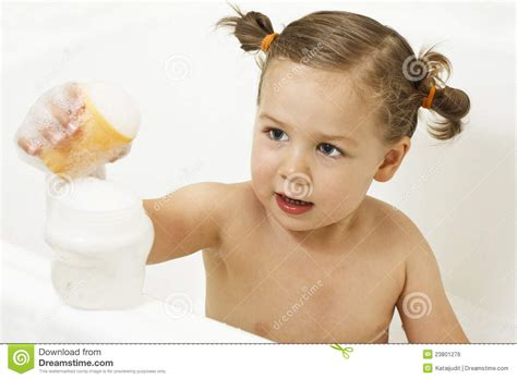 little girls in the bathtub cute little girl playing in bath royalty free stock image