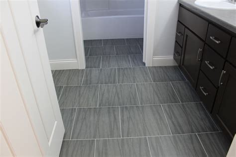 bathroom with grey tile floor what s hot in tile showers right now and other flooring
