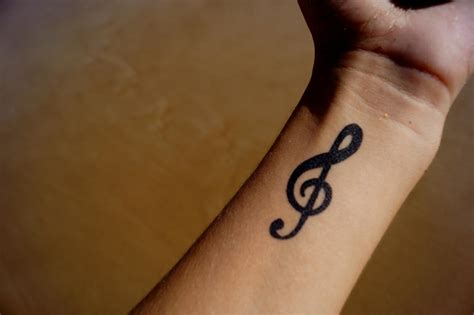 music symbol tattoo want a wrist check these bold designs and their