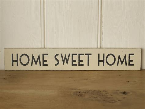 home sweet home wooden sign by the original home store