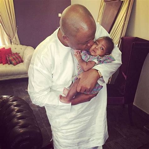 davido shares adorable photo of his father holding his