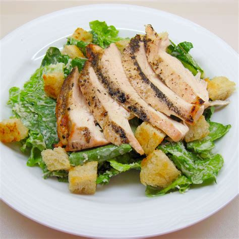 chicken salad caesar salad with grilled chicken in the kitchen with kath