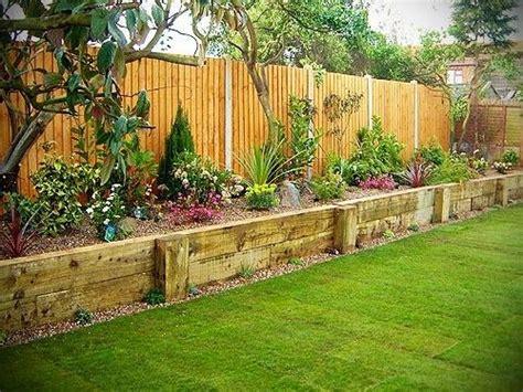 Raised Flower Bed Along Fence Garden Along Fence Yards Raised Garden Fence Ideas