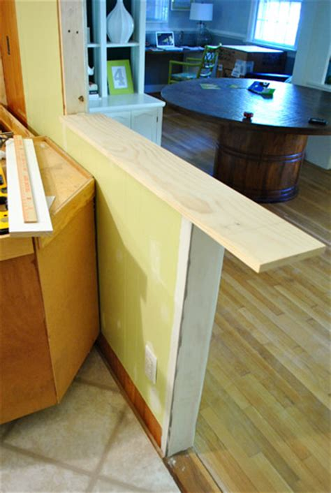 Divider Between Kitchen And Living Room how to trim out a cased opening and a half wall young