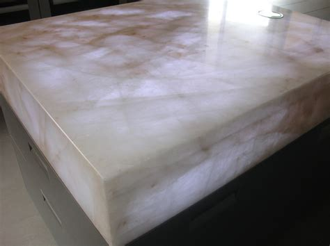 Cristallo quartzite mitred island with popup power sockets