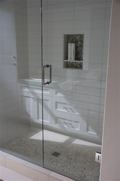 bathroom tile showrooms white shower with glass mosaic niche and pebble floor
