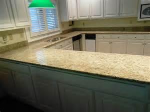 Giallo ornamental granite exceptional for white cabinets traditional