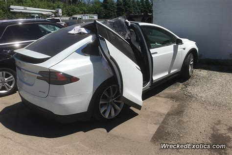 How Do You Open A Tesla Door Ouch Don T Leave The Garage With Your Tesla Falcon Wing