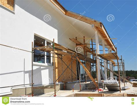 fixing house windows construction or repair of the rural house with skylights eaves windows fixing