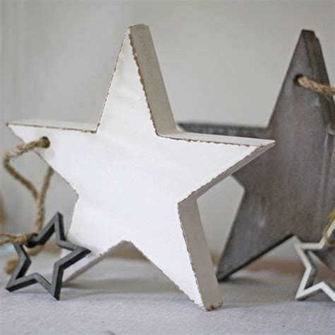 wooden star christmas decorations by the wedding of my