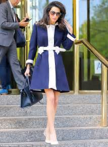Amal clooney looks stunning in chic blue and white overcoat as she