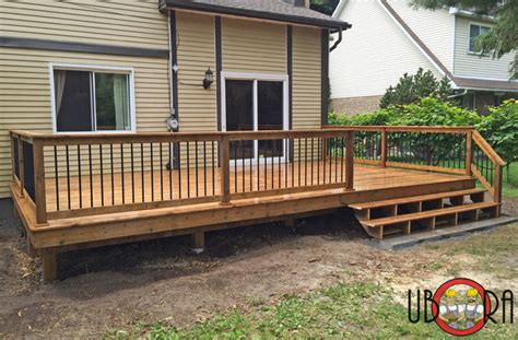 wood deck with black metal spindle railings deck other